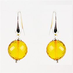 Multi faceted clear honey amber earrings set in sterling silver.  Stylish and unique.