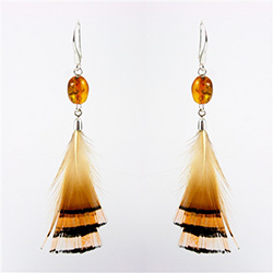 Honey amber drops with stylish feathers with sterling silver findings. Stylish and unique.