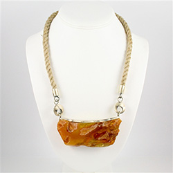 This fine amber nugget has been partially polished to show off both it's natural and polished surfaces.  Accented with brushed silver findings and holder.  Adjustable silver chain attached.