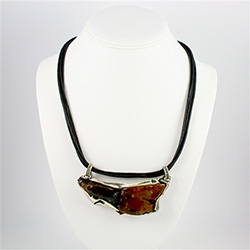 Two contrasting amber nuggets framed in an artistic brushed silver setting.