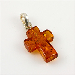 Free form piece of Baltic amber in the shape of a cross.  Size and weight vary.