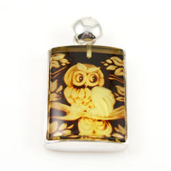 "Beautifully carved owl in rectangular shaped amber pendant framed in sterling silver. Size approx. .8"" x 1.25"" - 2cm x 3cm (including finding.  Cameo is square shaped."