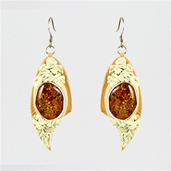 "Two sparkling honey amber cabochons set in white leather.  2.5"" long.  We have several sets of these so they will vary from set to set as they are all hand made."