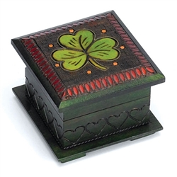 Shamrock Chest Polish Box, Rich green finish w/multi-color, hand painted and brass inlaid shamrock motif on top with burned detail on 3 of the sides. Footed base.