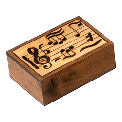 Take Note! Polish Box. The treble clef, the key of B flat, and a variety of notes decorate the lid of this box. Hand stained and hand carved. Walnut finished borders and sides.