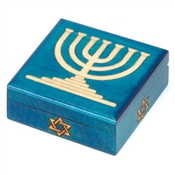 Menorah Polish Box. This box is decorated with a blue finish and a menorah outlined with metal inlay. A Star of David decorates the front of the box.