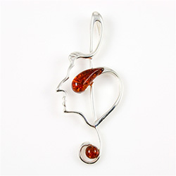 Hand made with Sterling Silver detail Amber. Use as a pendant or as a pin.