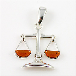 Hand made Cognac Amber Libra pendant with Sterling Silver detail.  September 23 - October 22