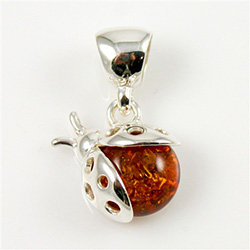 Hand made Cognac Amber Ladybug Pendant with Sterling Silver detail.