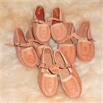 These miniature versions are made of pigskin, come with plastic soles and are sized in centimeters.