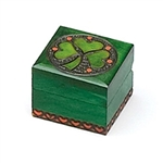 A Bit More Luck Shamrock Polish Box. This Irish green box features a shamrock inside a metal inlaid circle with red circles for accent. Entire design is hand-carved.