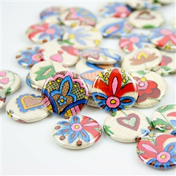 These small pinback buttons are bright and colorful, featuring traditional Polish Kashubian printed embroidery designs. We make these buttons in house, a Polish Art Center exclusive!