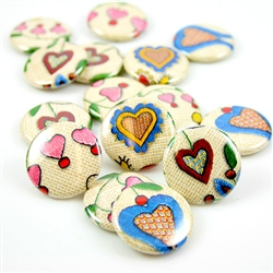 These small pinback buttons are bright and colorful, featuring traditional Polish Kashubian printed embroidery heart designs. We make these buttons in house, a Polish Art Center exclusive!