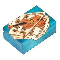 This box features a violin and bow resting on top of several sheets of music. A vibrant blue stain completes the design.