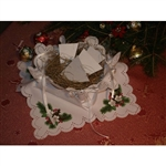 "Beautiful two part white centerpiece in a Christmas holiday print.  The center ties together to create a ""bed"" for your Christmas hay (sianko).  Perfect for the Christmas Eve table.  Hay is included."