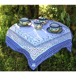 "Beautiful floral pattern tablecloth produced by ""Manufaktura"" , a stoneware company in Boleslawiec, Poland.  Company symbol (also found on all their stoneware) is printed in one corner."