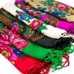 Beautiful cotton folk scarf with a screen-printed folk design surrounded by fringe.  Choose from 11 different colors.  Please note that there are two slightly different patterns.  Most are a floral and paisley combination but a few have only a floral patt
