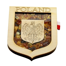 Hand made of wood and filled with amber this very attractive magnet features the Polish Eagle. the national emblem of Poland.  Attached on the right side are the colors of the Polish flag.