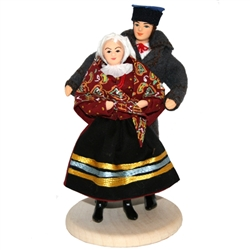 This traditional Sandomierz couple is completely hand made the old fashioned way with papier mache, dress materials and paints.  The doll is clothed in authentic regional folk costume as certified by the Polish Ministry of Culture.  Notice the attention t