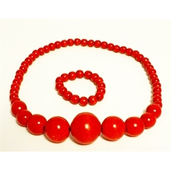 "This colorful folk necklace and bracelet are made of natural wooden beads painted and varnished.  The bracelet and necklace are both on stretchy cord. Necklace is 24"" - 61cm long"