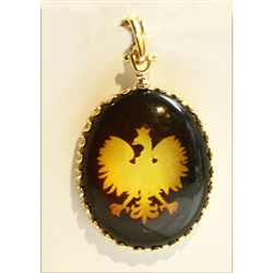 The Polish Eagle is etched on the back side of this clear amber cabochon.  Set in a frame and finding of 14 karat gold this is an exquisite piece of jewelry.