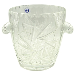 Lovely crystal ice bucket.  This is genuine Polish lead crystal hand cut with a star burst design.