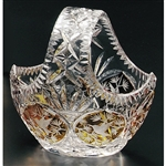 "Amber colored cased crystal is a Polish specialty.  Hand cut and polished from the ""Julia"" factory in Poland,  These crystal baskets are uniquely Polish with 6 intricate hummingbird designs cut all around the basket."