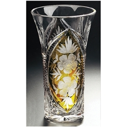 "Amber colored cased crystal is a Polish specialty.  Hand blown, cut and polished from the ""Julia"" factory in Poland,  this beautifully shaped vase features flowers on two sides."