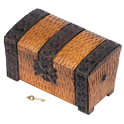Chest comes with a built in lock (key provided)., hand carved decoration, curved lid.Lock and key, hand carved decoration, curved lid.