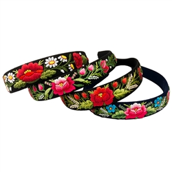 This is a flexible headband that has been covered in black material that has been hand embroidered in a Lowicz style floral pattern.  Made in Lowicz, Poland. No two are alike.