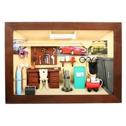 Poland has a long history of craftsmen working with wood in southern Poland. Their workshops produce beautiful hand made boxes, plates and carvings.  This shadow box is a look inside a traditional Polish vehicle repair shop.  Note the nice attention to de
