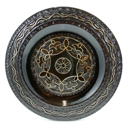 Polish wooden plates are made from Linden wood in the mountain region of southern Poland called Podhale.  The plates are cut and shaped on a lathe by hand.  The floral designs are burned into the wood then painted after staining and varnishing.