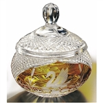 "Amber colored cased crystal is a Polish specialty.  Hand blown, cut and polished from the ""Julia"" factory in Poland,  this beautiful covered candy dish features a swan on two sides. Beautiful etching."