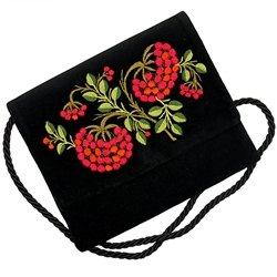 "Hand embroidered shoulder purse made from velvet.  Fully lined.  Extra long strap (extends to approx 30""). Snap closure.  Made in Lowicz, Poland."