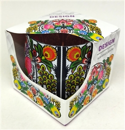 Very colorful and very traditional Polish paper cut motif graces this gorgeous glass candle holder.  The paraffin candle has a pleasant floral aroma.