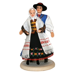This traditional Goral couple from the Lower Beskid mountain region is completely hand made the old fashioned way with papier mache, dress materials and paints.  The doll is clothed in authentic regional folk costume as certified by the Polish Ministry of