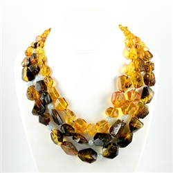 Bozena Przytocka is a designer of artistic amber jewelry based in Gdansk, Poland.   Here is a beautiful example of her ability to blend different shades of amber and aquamarine to create a stunning necklace.