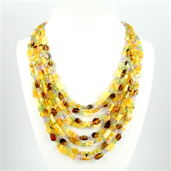 "Bozena Przytocka is a designer of artistic amber jewelry based in Gdansk, Poland. Here is a beautiful example of her ability to blend amber, amethyst and peridot to create a stunning necklace. 18"" length is the shortest strand. There is a 4"" drop from th"