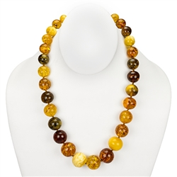 This timeless Amber necklace showcases a unique variety of Amber shades from milky white to cognac. The beauty of this necklace will last a lifetime.
