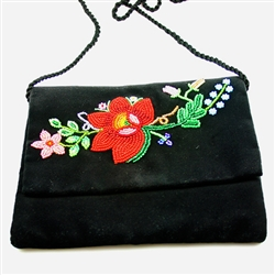 "Hand beaded shoulder purse made from velvet.  Fully lined.  Extra long strap (extends to 30""). Snap closure.  Made in Lowicz, Poland.  Flower colors and design vary slightly from purse to purse."
