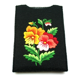 Soft black felt sewn case with Lowicz style embroidered flowers on one side. ​