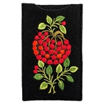 Soft black felt sewn case with Lowicz style embroidered flowers on one side.
