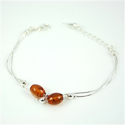 Oval honey amber beads set in sterling silver.