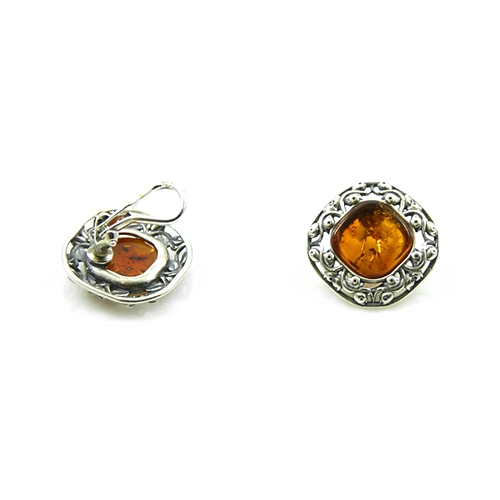 Attractive Honey Amber Set In A Filigree Style Sterling Silver Setting