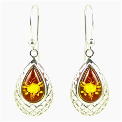A beautiful floral cameo is carved into the back of each tear drop shaped amber cabochon.