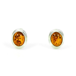 Open back oval amber earrings set in silver really highlight the amber inclusions.
