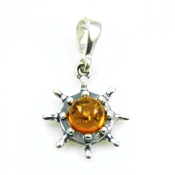 Beautiful honey amber sphere suspended by a sterling silver attachment.