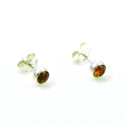 Baltic Amber stud earrings with sterling silver detail.  Size is approx 5mm diameter.