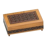 Very intricate hand carved design. Footed base. Walnut finish.