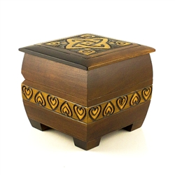 "The stained locking chest is perfect to lock away any special treasure. The box is square in shape with rounded edges for a softer look. It has 4 square feet that raise the box by 3/8"". The top is ornamented with brass inlay and sides with a burnt carving"